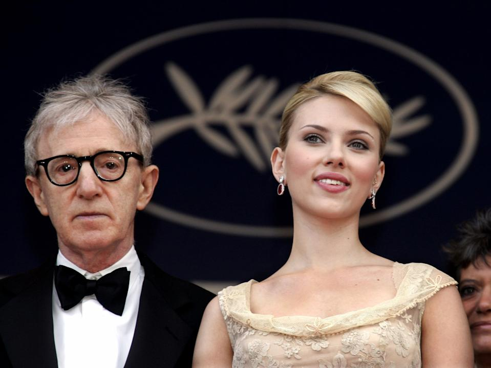 """U.S. director Woody Allen (L) poses with U.S. actress Scarlett Johansson during red carpet arrivals for the out-of-competition screening of his film """"Match Point"""" at the 58th Cannes Film Festival in this May 12, 2005 file photo. There's an undercurrent of deja vu coursing through Woody Allen's new comedy """"Scoop,"""" starting with its London setting. But perhaps most significantly, Scarlett Johansson, the leading lady of Allen's last film, """"Match Point,"""" once again plays a displaced American woman -- though in """"Scoop"""" she's more damsel in distress than femme fatale. REUTERS/Pascal Deschamps/Files (FRANCE)"""