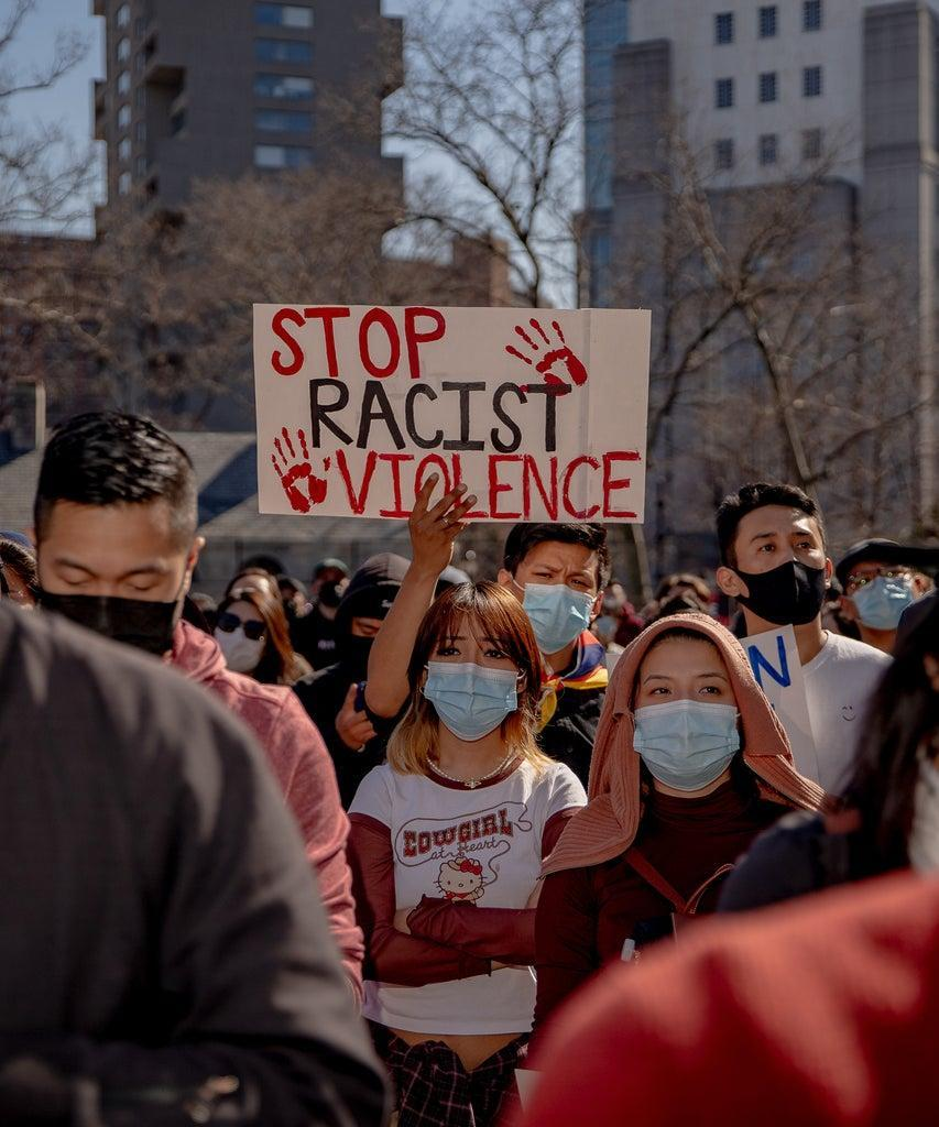 Demonstrators hold signs during an AAPI Rally Against Hate in New York, U.S., on Sunday, March 21, 2021. Stop AAPI Hate, a group that tracks anti-Asian violence, said it had received nearly 3,800 reports of hate incidents since mid March, 2020, around the time that the Covid-19 pandemic seized the U.S. More than 500 of those came in the first two months of 2021. Photographer: Amir Hamja/Bloomberg via Getty Images