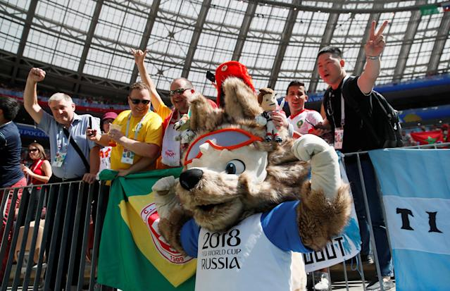 Soccer Football - World Cup - Group B - Portugal vs Morocco - Luzhniki Stadium, Moscow, Russia - June 20, 2018 Fans pose with World Cup mascot Zabivaka inside the stadium before the match REUTERS/Maxim Shemetov