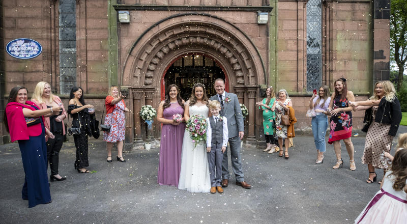 David D'Arcy and his wife Hayley Collins get married during their socially distanced wedding at St Anne's Church in Aigburth, Liverpool, as the lifting of further lockdown restrictions in England comes into effect. (Photo by Peter Byrne/PA Images via Getty Images)
