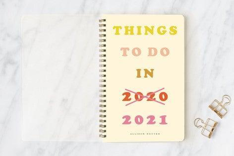 """<h3><a href=""""https://www.minted.com/product/journals/MIN-ZUD-NBK/things-to-donext-year"""" rel=""""nofollow noopener"""" target=""""_blank"""" data-ylk=""""slk:Minted Things To Do Next Year Notebook"""" class=""""link rapid-noclick-resp"""">Minted Things To Do Next Year Notebook</a></h3> <br>Record your thoughts and plans while supporting your local community with this customizable notebook planner or address book created by Minted's global community of independent designers. Plus, a portion of every sale from this collection goes to <a href=""""https://www.minted.com/https://www.frontlinefoods.org/"""" rel=""""nofollow noopener"""" target=""""_blank"""" data-ylk=""""slk:Frontline Foods"""" class=""""link rapid-noclick-resp"""">Frontline Foods</a> to help support restaurants and feed healthcare workers on the frontlines.<h3><a href=""""https://www.minted.com/product/journals/MIN-ZUD-NBK/things-to-donext-year"""" rel=""""nofollow noopener"""" target=""""_blank"""" data-ylk=""""slk:"""" class=""""link rapid-noclick-resp""""><br></a></h3><br><br><br><strong>Yours Madly</strong> Things to do...next year Notebooks, $, available at <a href=""""https://go.skimresources.com/?id=30283X879131&url=https%3A%2F%2Fwww.minted.com%2Fproduct%2Fjournals%2FMIN-ZUD-NBK%2Fthings-to-donext-year"""" rel=""""nofollow noopener"""" target=""""_blank"""" data-ylk=""""slk:Minted"""" class=""""link rapid-noclick-resp"""">Minted</a><br><br>"""