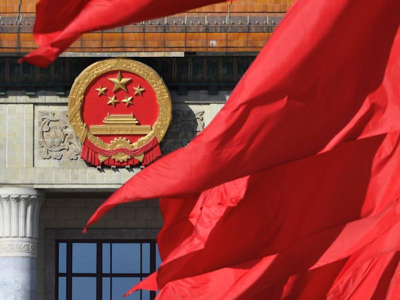 Red flags flutter outside the Great Hall of the People during the closing session of the Chinese People's Political Consultative Conference (CPPCC) in Beijing, China March 13, 2019. REUTERS/Stringer ATTENTION EDITORS - THIS IMAGE WAS PROVIDED BY A THIRD PARTY. CHINA OUT. - RC14EB7A56F0