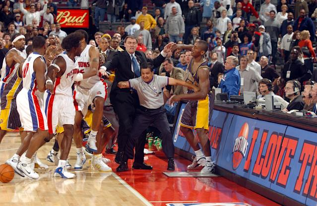 Ben Wallace and his Detroit Pistons teammates are kept apart from Ron Artest (R) of the Indiana Pacers by Pacers head coach Rick Carlisle and official Tommy Nunez Jr. on Nov. 19, 2004, during their game at The Palace of Auburn Hills. (Getty Images)