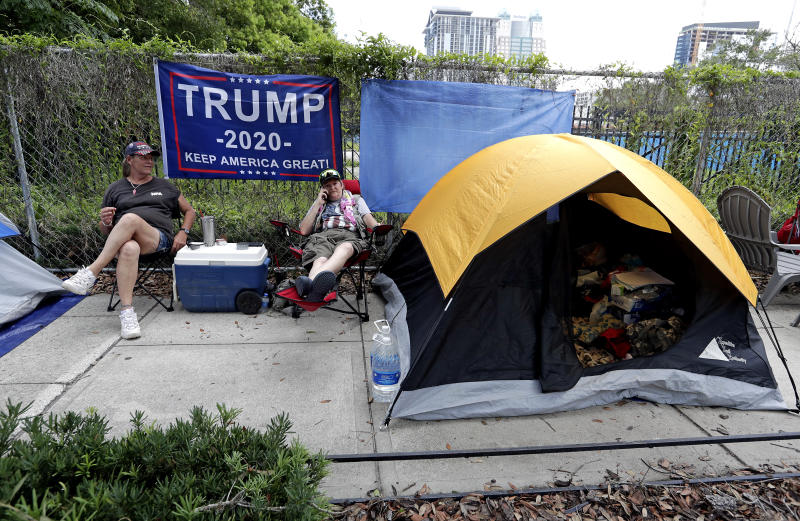 Supporters of President Trump, seen here Monday, were lined up more than 24 hours before his rally in Orlando. (AP Photo/John Raoux)