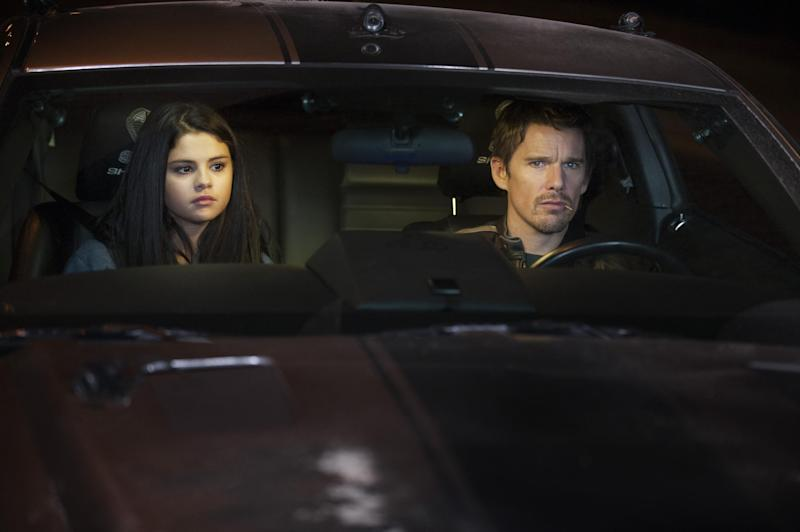"""This film image released by Warner Bros. Pictures shows Selena Gomez, left, and Ethan Hawke in a scene from """"Getaway."""" (AP Photo/Warner Bros. Pictures, Simon Varsano)"""