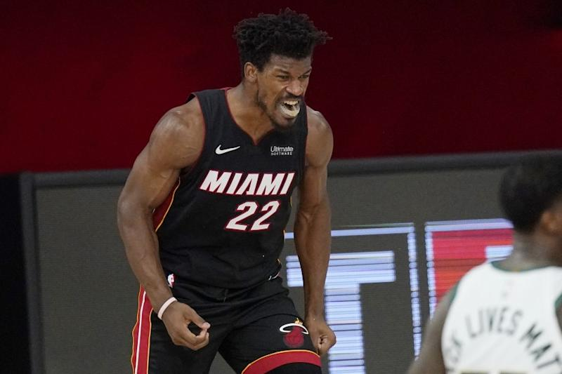 Miami Heat's Jimmy Butler (22) celebrates after a dunk in the second half of an NBA conference semifinal playoff basketball game against the Milwaukee Bucks Friday, Sept. 4, 2020, in Lake Buena Vista, Fla. (AP Photo/Mark J. Terrill)