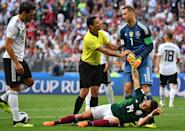 <p>Iranian referee Alireza Faghani (2ndL) talks to Germany's goalkeeper Manuel Neuer (R) trying to help Mexico's forward Javier Hernandez lying on the pitch during the Russia 2018 World Cup Group F football match between Germany and Mexico at the Luzhniki Stadium in Moscow on June 17, 2018. (Photo by Yuri CORTEZ / AFP) </p>