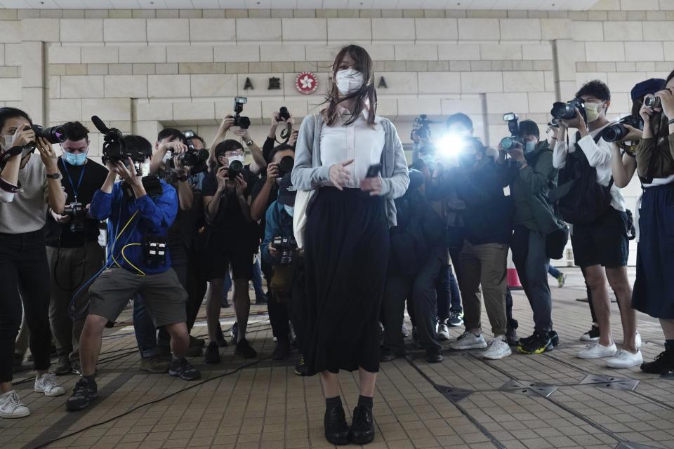 Hong Kong activist Agnes Chow arrives at a court in Hong Kong, Monday, Nov. 22. 2020. Hong Kong pro-democracy activists Joshua Wong, Agnes Chow and Ivan Lam appear at court for their trial, as the trio faces charges related to the besieging of a police station during anti-government protests last year. (AP Photo/Vincent Yu)