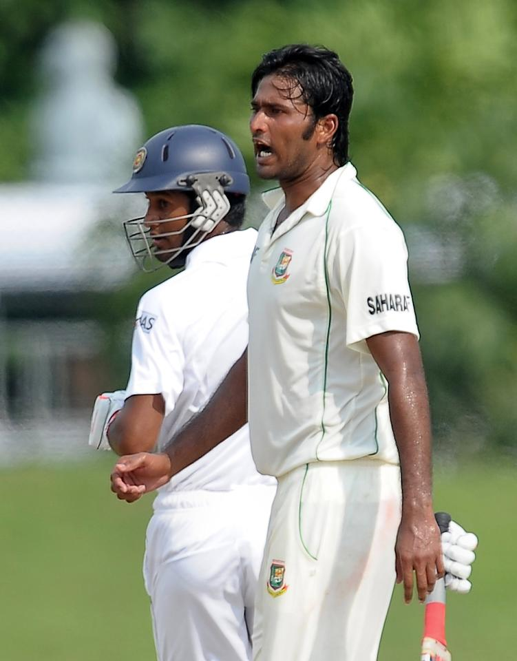 Bangladeshi cricketer Shahadat Hossain (R) celebrates the dismissal of Sri Lankan batsman Dimuth Karunaratne (L) during the fourth day of the opening Test match between Sri Lanka and Bangladesh at the Galle International Cricket Stadium in Galle on March 11, 2013. Bangladesh were bowled out for 638 in their first innings in reply to Sri Lanka's 570-4 declared on the fourth day of the opening Test in Galle on Monday. AFP PHOTO/ LAKRUWAN WANNIARACHCHI        (Photo credit should read LAKRUWAN WANNIARACHCHI/AFP/Getty Images)