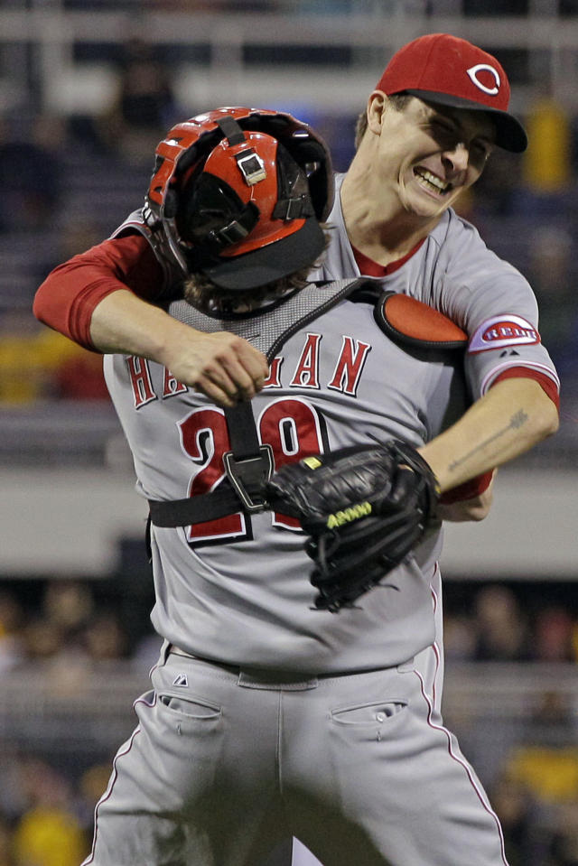 Cincinnati Reds starting pitcher Homer Bailey, right, celebrates with Cincinnati Reds catcher Ryan Hanigan (29) after getting the final out of a no-hitter in a baseball game against the Pittsburgh Pirates in Pittsburgh Friday, Sept. 28, 2012. The Reds won 1-0. (AP Photo/Gene J. Puskar)
