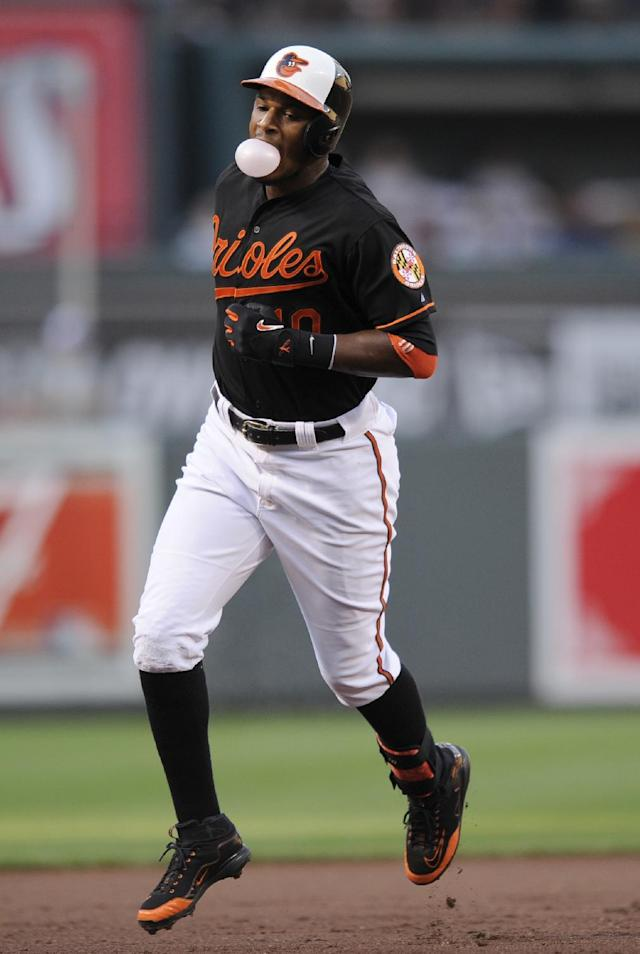 Baltimore Orioles' Adam Jones rounds the bases afterhitting a two-run home run against the Boston Red Sox during the first inning of a baseball game on Friday, July 26, 2013, in Baltimore. (AP Photo/Nick Wass)