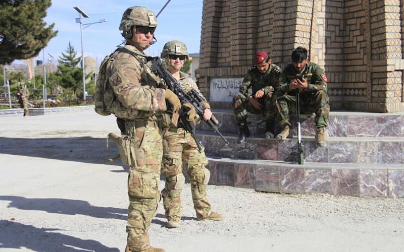 US soldiers stand guard during a Nato meeting in Afghanistan - REX