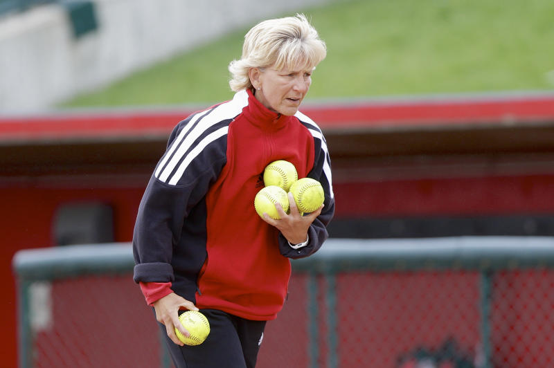Nebraska coach Rhonda Revelle collects softballs during practice in Lincoln, Neb., Wednesday, May 22, 2013. Nebraska plays Oregon in a best-of-three NCAA college softball Super Regional series starting Saturday night in Eugene, Ore. (AP Photo/Nati Harnik)