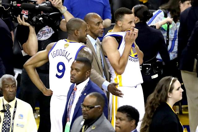 Andre Iguodala (left) and Stephen Curry of the Golden State Warriors react after defeat to the Cleveland Cavaliers in Game 7 of the NBA Finals, in Oakland, California, on June 19, 2016 (AFP Photo/Ronald Martinez)