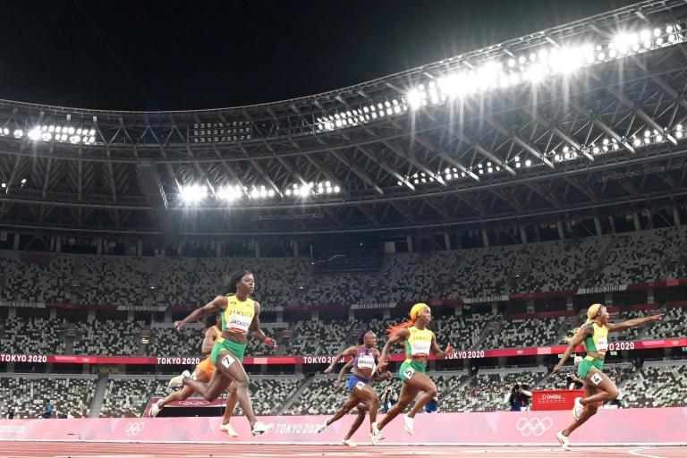 Elaine Thompson-Herah, right, and the two Jamaican compatriots who followed her home for Olympic 100m medals, Shelly-Ann Fraser-Pryce and Shericka Jackson (L) in the women's Olympic 100m final