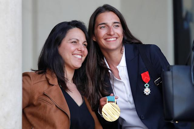 Former French Olympic champion Sandra Laoura (L) poses with Perrine Laffont (R), French Olympic gold medalist in the moguls event in freestyle skiing during the Pyeongchang 2018 Winter Olympic Games after an award ceremony gathering French athletes that competed in the 2018 Pyeongchang Olympics winter Games, at the Elysee Palace in Paris, France, April 13, 2018. Reuters/Charles Platiau