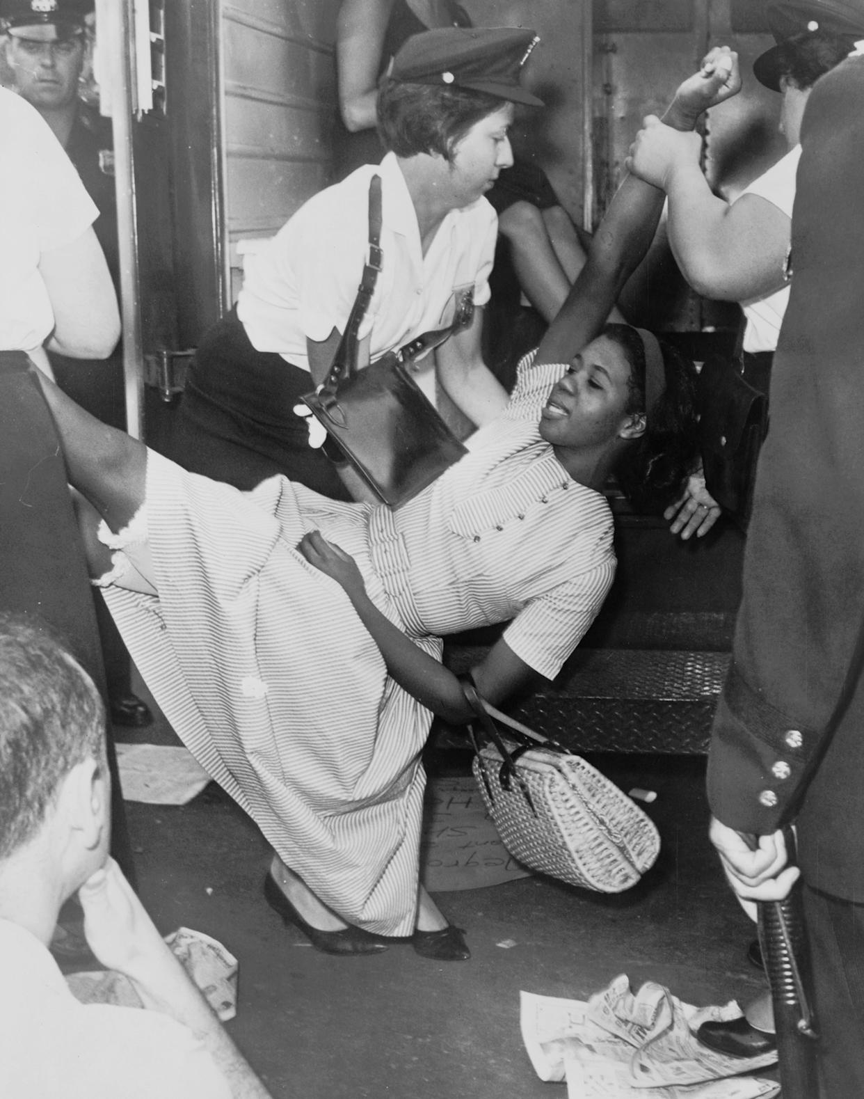 African American woman being carried to police patrol wagon during demonstration in Brooklyn, New Yorkcirca 1963.