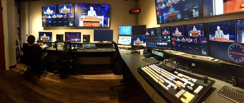 Volunteer in Rock Springs Baptist Church's Media Ministry oversees live streaming production of the main service