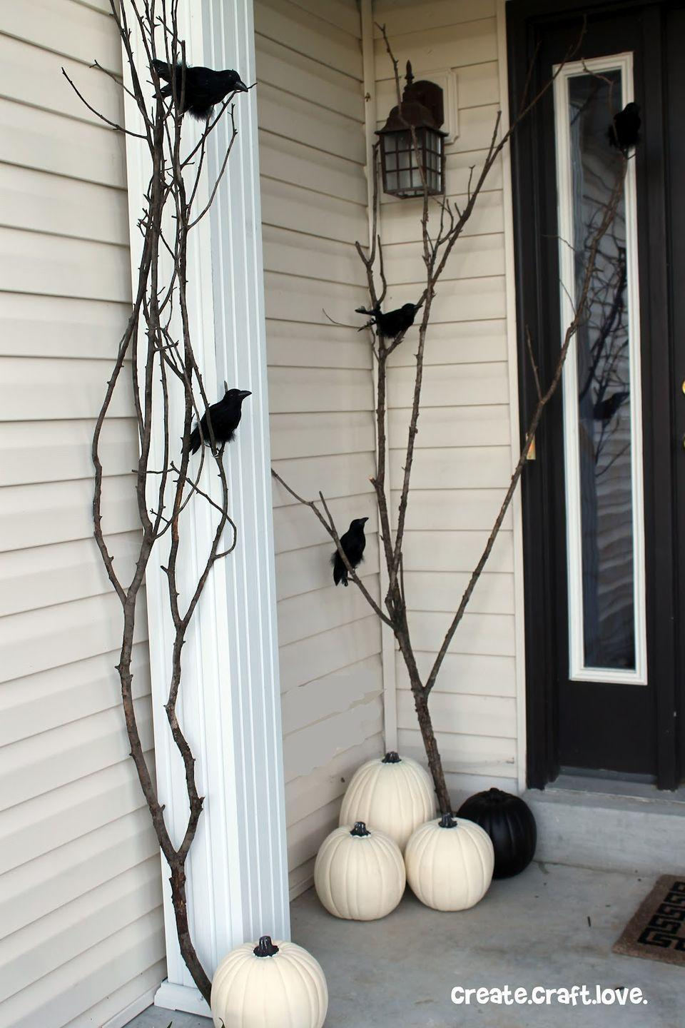 """<p>Create this ultra spooky setup with long branches and tied-on ravens. Though fake, they look almost real enough to terrify the neighbors!<br></p><p><strong>Get the tutorial at <a href=""""http://www.createcraftlove.com/raven-inspired-halloween-porch/"""" rel=""""nofollow noopener"""" target=""""_blank"""" data-ylk=""""slk:Create Craft Love"""" class=""""link rapid-noclick-resp"""">Create Craft Love</a>.</strong> </p>"""