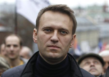 Russian opposition leader Alexei Navalny walks during an opposition rally in Moscow