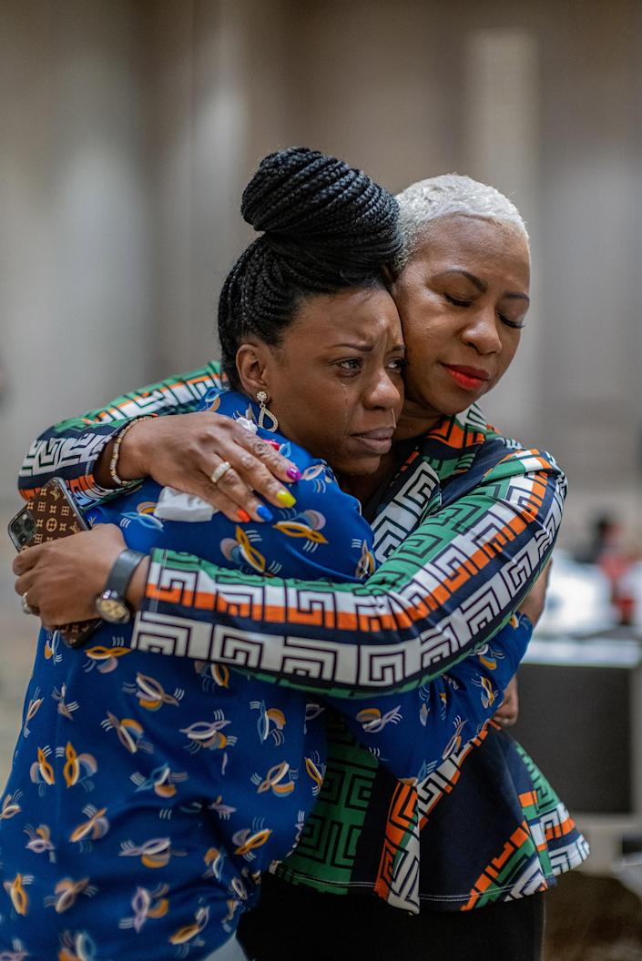 """After anxiously waiting for the news, Tedra McGee hugs her mother, Shareeduh McGee, Floyd's cousin, just after the verdicts were read.<span class=""""copyright"""">Ruddy Roye for TIME</span>"""