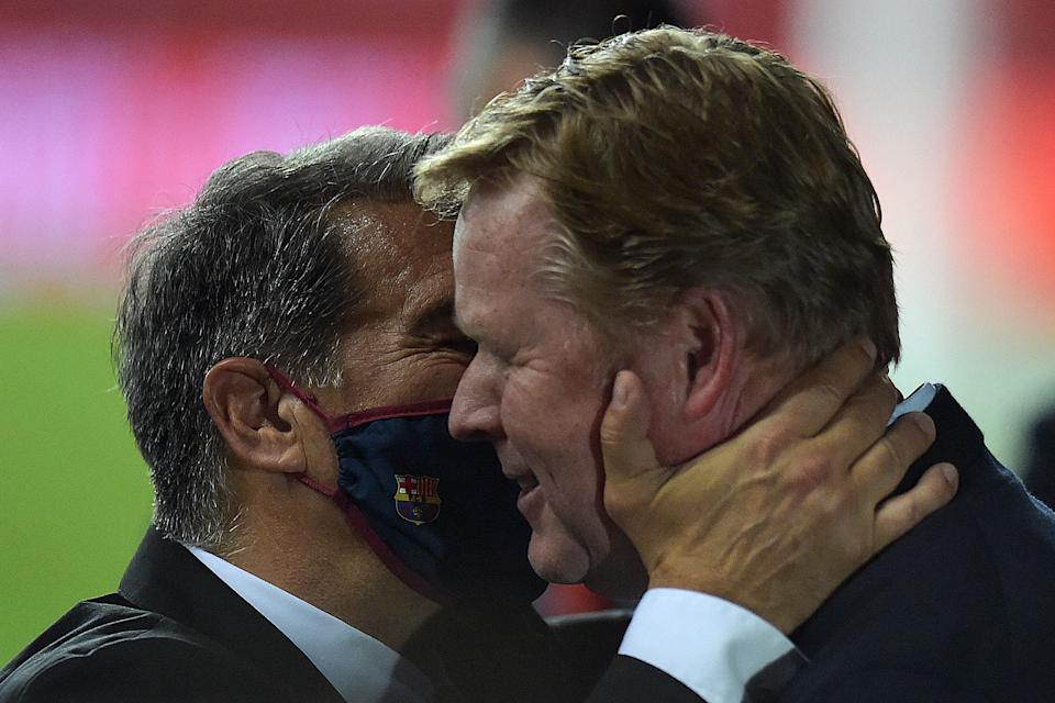 Barcelona's Dutch coach Ronald Koeman (R) celebrates with club president Joan Laporta at the end of the Spanish Copa del Rey (King's Cup) final football match between Athletic Club Bilbao and FC Barcelona at La Cartuja stadium in Seville on April 17, 2021. (Photo by CRISTINA QUICLER / AFP) (Photo by CRISTINA QUICLER/AFP via Getty Images)