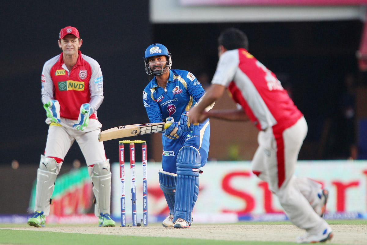 Dinesh Karthik looks on as Piyush Chawla takes the catch during match 69 of the Pepsi Indian Premier League between The Kings XI Punjab and the Mumbai Indians held at the HPCA Stadium in Dharamsala, Himachal Pradesh, India on the on the 18th May 2013. (BCCI)