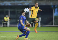 Australia's Chris Ikonomidis, right, attempts a head at goal in front of Kuwait's Khaled Ibrahim during the World Cup 2022 Group B qualifying soccer match between Kuwait and Australia in Kuwait City, Kuwait, Thursday, June 3, 2021. (AP Photo/Jaber Abdulkhaleg)