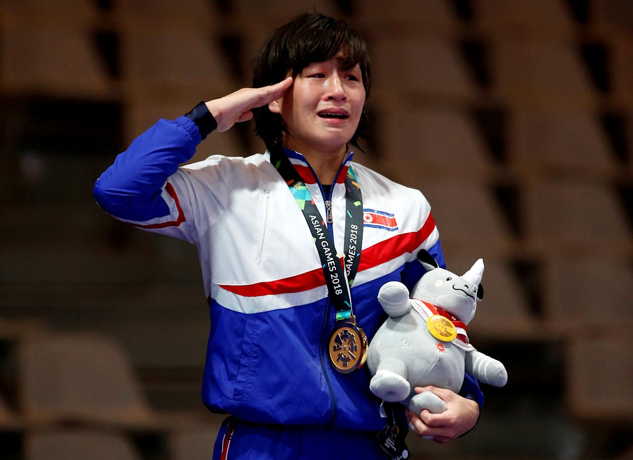 Wrestling - 2018 Asian Games – Women's Freestyle 57 kg Medal Ceremony - JCC – Assembly Hall - Jakarta, Indonesia – August 20, 2018 –  Gold medalist Jong Myong Suk of North Korea listens to the national anthem. REUTERS/Willy Kurniawan      TPX IMAGES OF THE DAY