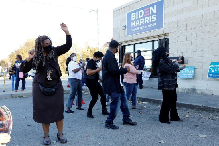 People celebrate the President-elect Joe Biden and Vice President-elect Kamala Harris in Detroit, Michigan