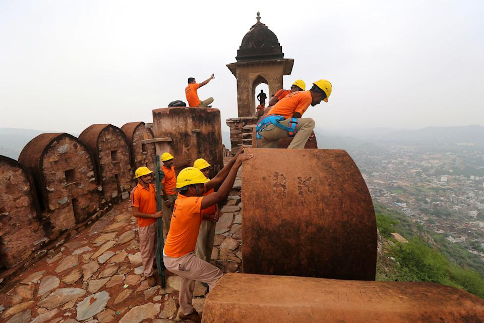 State Disaster Response personnel perform a search operation at a watchtower of the 12th century Amber Fort where 11 people were killed Sunday after being struck by lightning in Jaipur, Rajasthan (AP)