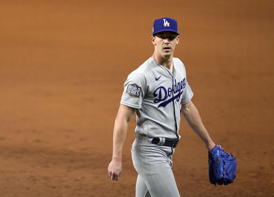 ARLINGTON, TX - OCTOBER 23: Walker Buehler #21 of the Los Angeles Dodgers walks off the field after the fourth inning of Game 3 of the 2020 World Series between the Los Angeles Dodgers and the Tampa Bay Rays at Globe Life Field on Friday, October 23, 2020 in Arlington, Texas. (Photo by Cooper Neill/MLB Photos via Getty Images)