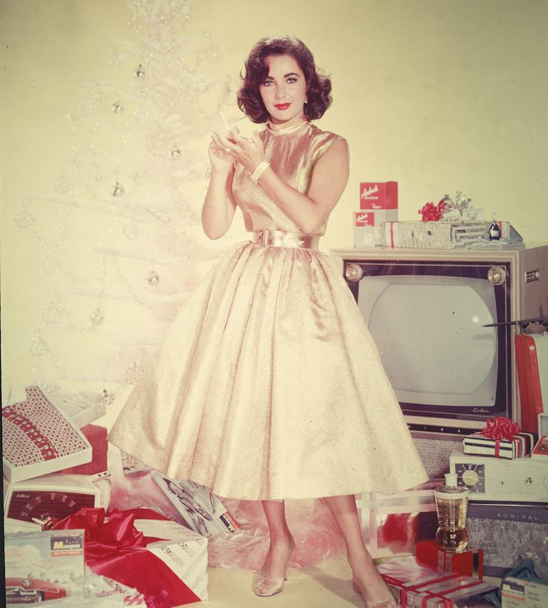 Taylor wears a satin dress in a Holiday-themed publicity portrait circa the 1950s.