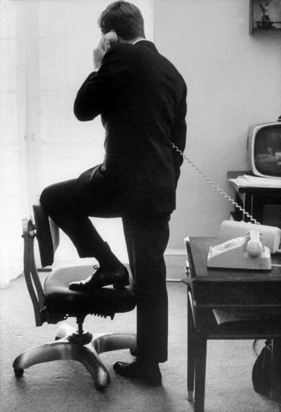<p>President Kennedy during a phone call. </p>