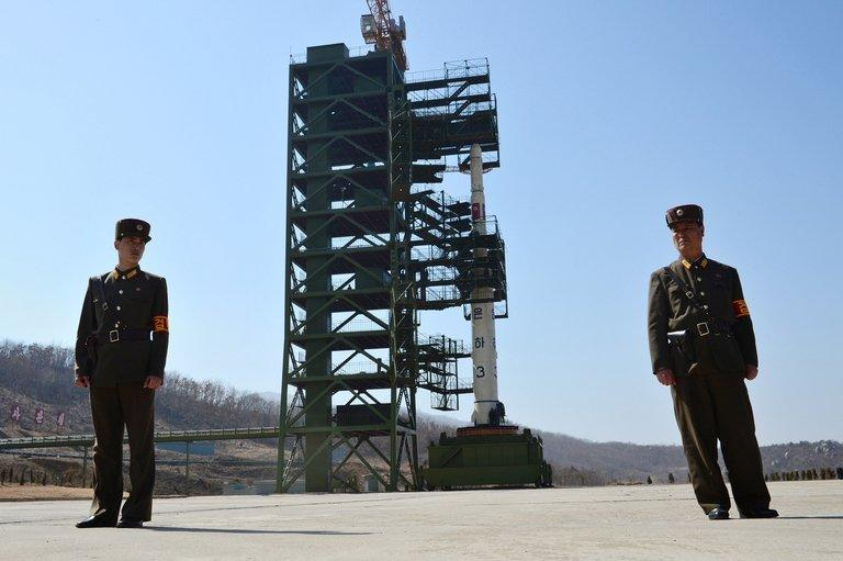Two North Korean soldiers stand guard in front of the Unha-3 rocket at Tangachai-ri space centre on April 8, 2012. Experts differ about the scale and immediacy of the military threat posed by North Korea's latest nuclear test, but there is little disagreement about the alarming proliferation risks it presents