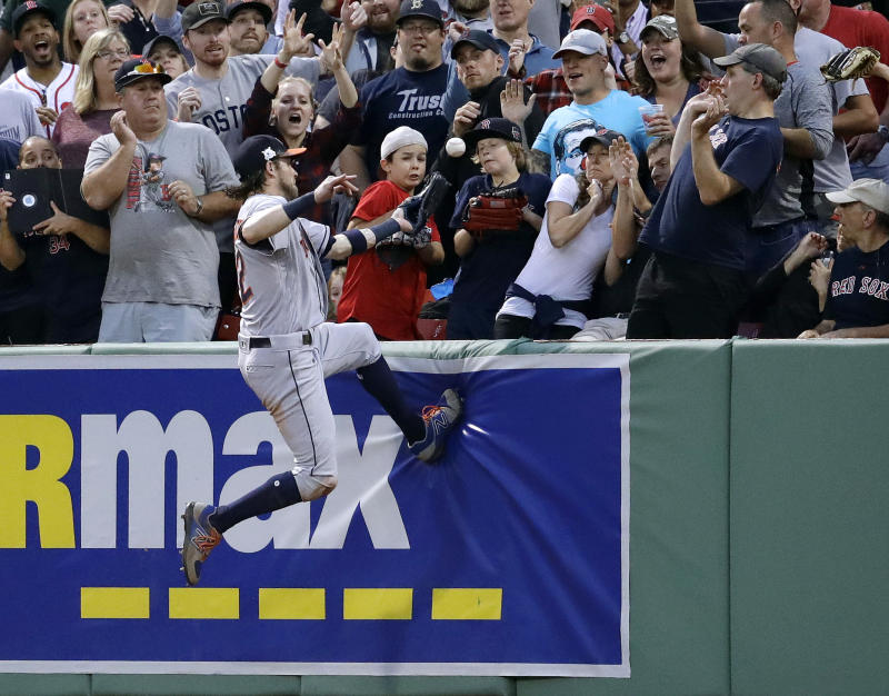Jackie Bradley Jr.'s home run bounces out of Josh Reddick's glove in ALDS Game 3. (AP)