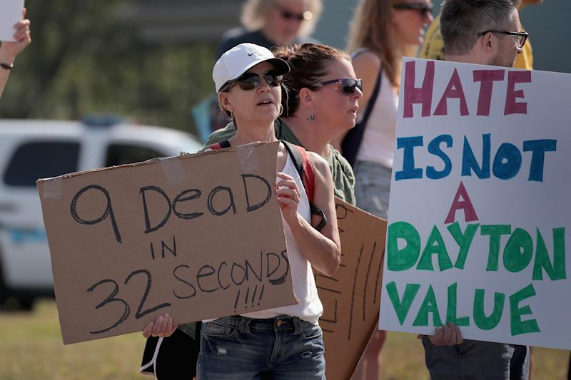 Demonstrators line the street near Miami Valley Hospital in anticipation of a visit from President Donald Trump on Aug. 7, 2019 in Dayton, Ohio. (Photo: Scott Olson/Getty Images)