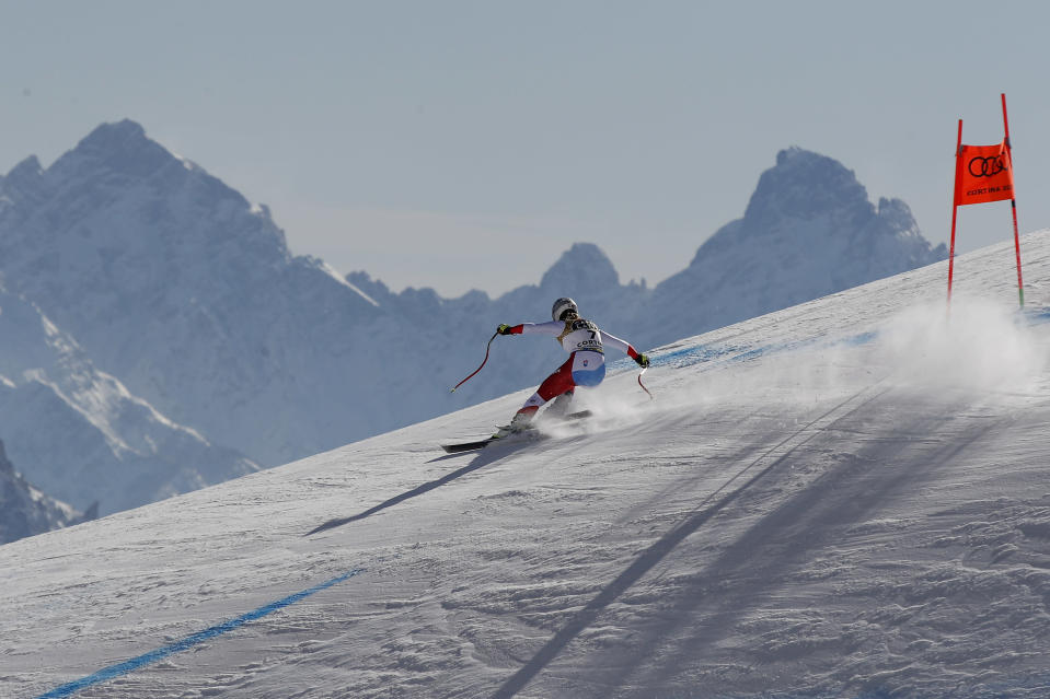 Switzerland's Corinne Suter speeds down the course on her way to win the women's downhill, at the alpine ski World Championships in Cortina d'Ampezzo, Italy, Saturday, Feb.13, 2021. (AP Photo/Gabriele Facciotti)