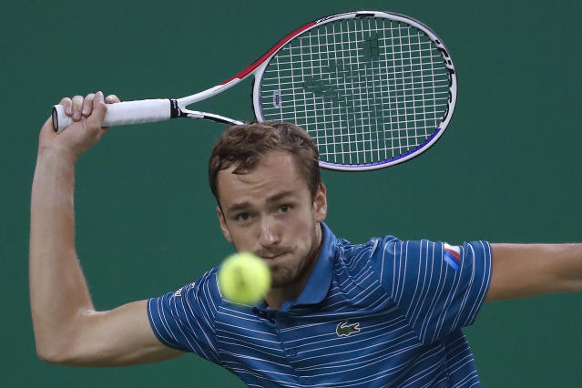 Daniil Medvedev of Russia eyes on the ball as he plays against Stefanos Tsitsipas of Greece in their men's singles semifinals match at the Shanghai Masters tennis tournament at Qizhong Forest Sports City Tennis Center in Shanghai, China, Saturday, Oct. 12, 2019. (AP Photo/Andy Wong)