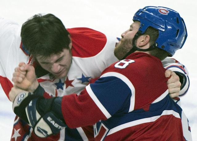 Montreal Canadiens' Brandon Prust, right, fights with Washington Capitals' Tom Wilson during the first period of an NHL hockey game in Montreal, Saturday, Jan. 25, 2014. (AP Photo/The Canadian Press, Graham Hughes)