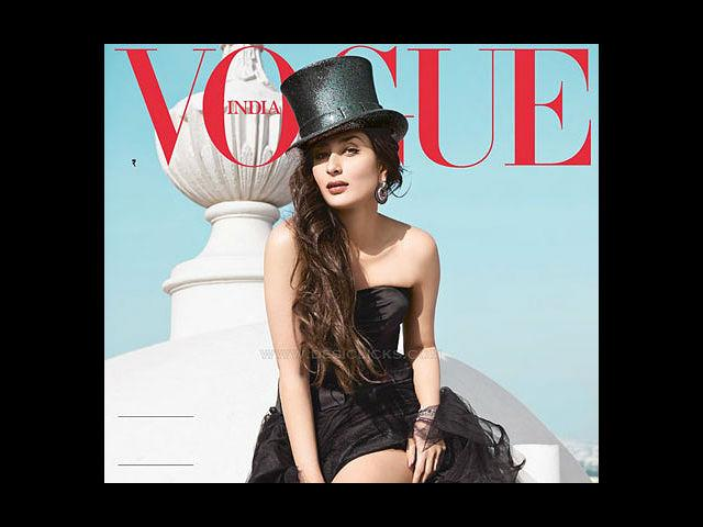 <b>1) Kareena Kapoor for Vogue, February</b><br>This woman is a freaking goddess as she looks like a dream in this strapless, black Dior gown. The lovely actress shows-off her well toned legs in a thigh-high split dress and a black top hat. Needless to say, hats off woman!