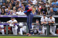 American League's Vladimir Guerrero Jr., of the Toronto Blue Jays, watches his solo home run take flight during the third inning of the MLB All-Star baseball game, Tuesday, July 13, 2021, in Denver. (AP Photo/Jack Dempsey)