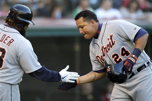 Detroit Tigers' Miguel Cabrera (24) celebrates with Prince Fielder after Cabrera hit a solo home run in the seventh inning of a baseball game, Saturday, Sept. 15, 2012, in Cleveland. (AP Photo/Tony Dejak)