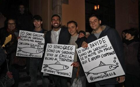 Supporters made posters featuring images of sardines