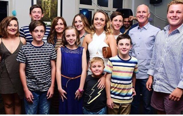 Jacinta poses with husband and ten living children