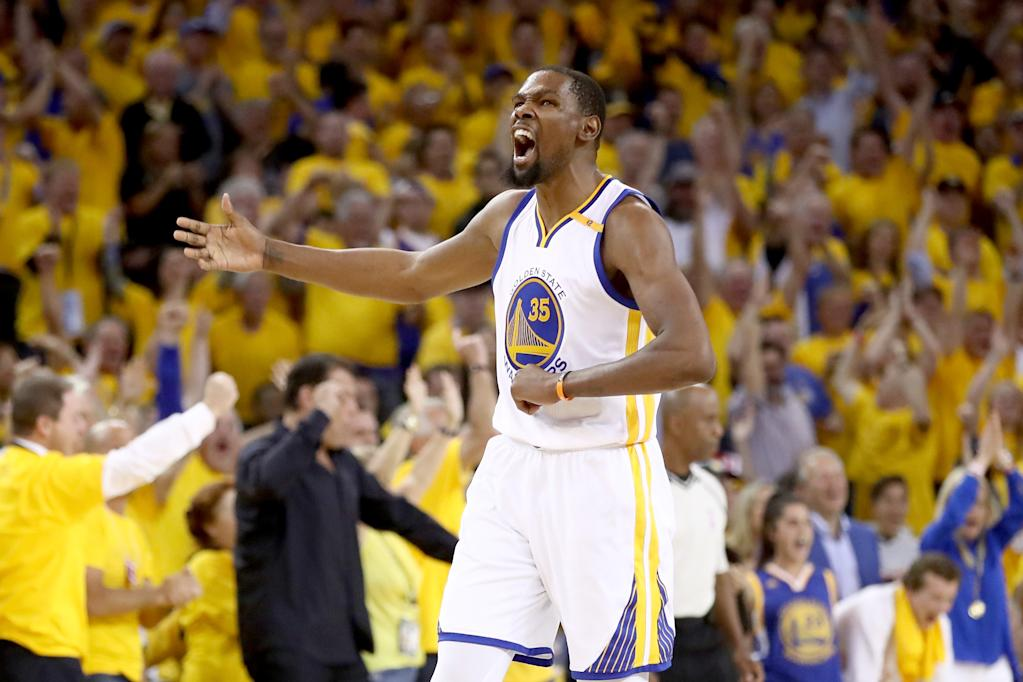 OAKLAND, CA - JUNE 12: Kevin Durant #35 of the Golden State Warriors reacts after a basket by Stephen Curry #30 in Game 5 of the 2017 NBA Finals at ORACLE Arena on June 12, 2017 in Oakland, California. NOTE TO USER: User expressly acknowledges and agrees that, by downloading and or using this photograph, User is consenting to the terms and conditions of the Getty Images License Agreement. Ezra Shaw/Getty Images/AFPOAKLAND, CA - JUNE 12: Kevin Durant #35 of the Golden State Warriors reacts after a basket by Stephen Curry #30 in Game 5 of the 2017 NBA Finals at ORACLE Arena on June 12, 2017 in Oakland, California. NOTE TO USER: User expressly acknowledges and agrees that, by downloading and or using this photograph, User is consenting to the terms and conditions of the Getty Images License Agreement. Ezra Shaw/Getty Images/AFP (AFP Photo/EZRA SHAW)