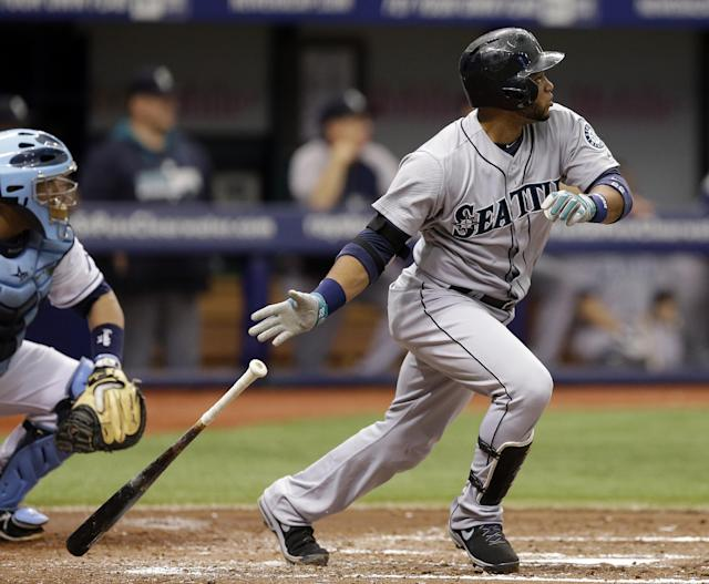 Seattle Mariners' Robinson Cano, right, follows the flight of his two-run single off Tampa Bay Rays starting pitcher David Price during the third inning of a baseball game Monday, June 9, 2014, in St. Petersburg, Fla. Mariners' Willie Bloomquist, and John Buck scored on the hit. Catching for the Rays is Jose Molina. (AP Photo/Chris O'Meara)