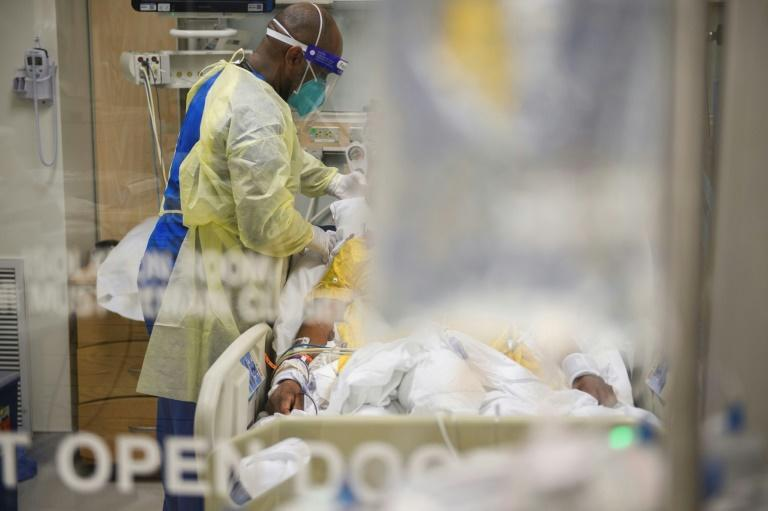 Nurses wearing personal protective equipment (PPE) attend to patients in a Covid-19 intensive care unit at Martin Luther King Jr. Community Hospital on January 6, 2021 in the Willowbrook neighborhood of Los Angeles, California