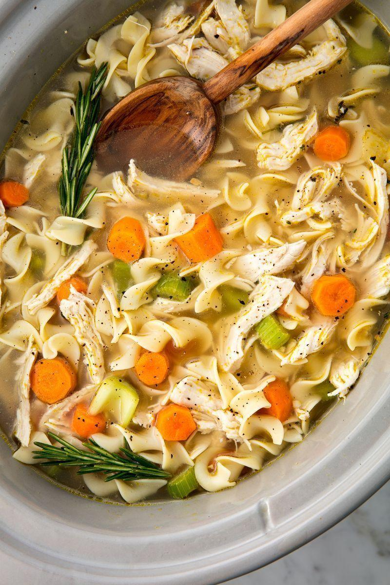 """<p>The easiest way to make the most comforting meal of all time.</p><p>Get the <a href=""""https://www.delish.com/uk/cooking/recipes/a29124077/easy-crockpot-chicken-noodle-soup-recipe/"""" rel=""""nofollow noopener"""" target=""""_blank"""" data-ylk=""""slk:Slow Cooker Chicken Noodle Soup"""" class=""""link rapid-noclick-resp"""">Slow Cooker Chicken Noodle Soup</a> recipe.</p>"""