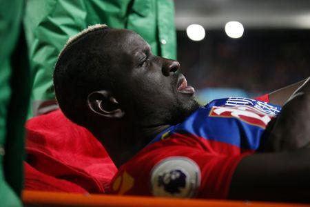 Crystal Palace's Mamadou Sakho is stretchered off after sustaining an injury